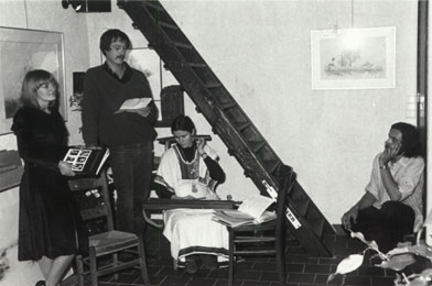 Poetry evening featuring Brigiet, Jan De Vuyst en Hilda Van Eyck during an exhibition in his studio, held in December 1980.